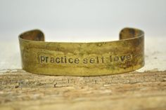 practice self love handstamped on brass CUFF by MYPEACEofJEWELRY, $25.00