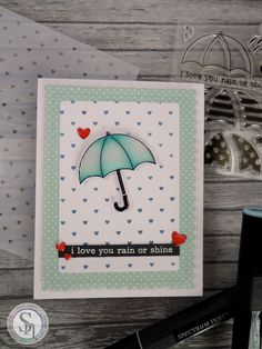 Designed by Tracy.  Stamps are by @clearlybesotted.  Coloured using Spectrum Noir Markers- BT1 & Bt2 and Spectrum Noir Colourblend pencil- Duck Egg.  #spectrumnoir #clearlybesotted #rainorshine #umbrella #colouring #craft #handmade #stamping #simonsaysstamp