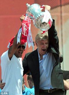 Theo and the boss lifting the fa cup