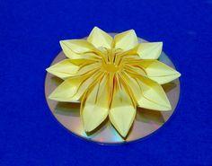 Easy 3d origami flower on CD. DIY origami room decorating ideas.