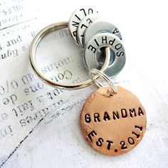 Let your Grandma know how you feel about her. Its a little token she can carry with her. You will receive: one 1 lightly hammered hand stamped copper disc four 3/4 hand stamped metal hardware washers one 1 1/4 steel split key ring We will stamp GRANDMA EST. and the year on the disc. If you would prefer something other than GRANDMA on the copper disc, we can stamp a different word up to 7 characters. We will stamp a name on each of the washers or word of your choice. Please let us k...