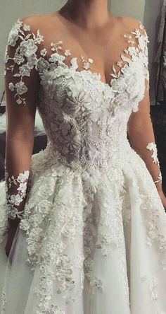 Dreaming of princess wedding dresses? Feel like royalty on your wedding day in one of these princess wedding dresses—a classic choice for brides planning a fairytale wedding. Wedding Dress Trends, Dream Wedding Dresses, Wedding Gowns, Wedding Ideas, Champagne Lace Wedding Dress, Floral Wedding Dresses, Sleeve Wedding Dresses, A Line Wedding Dress With Sleeves, Lace Weddings