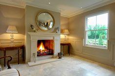 Bath stone Georgian fireplace in a beautiful room.