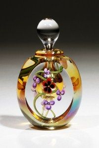 GlassMaster Roger Gandelman's Gold Luster Floral perfume bottle (short version). Light gold luster, red and black flowers, highlighted by pretty yellow edged flower in center & red interior bubble.