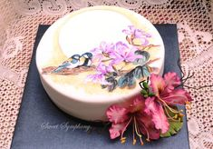 Bauhinias with hand painted birds - Cake by SweetSymphony