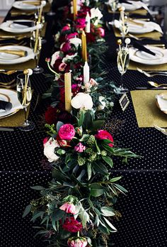 Dark greenery and bright pink-and-white garden roses and peonies are super dramatic