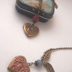 Heart locket necklace vintage victorian style Ruby / Aquamarine. €14.50, via Etsy.
