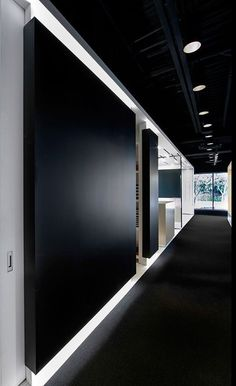 Black does not have to be scary! It makes a huge statement in this corporate black work space.