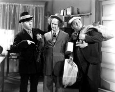 """ANTS IN THE PANTRY (Episode 12-1936) A. Mouser, the owner of the Lightning Exterminating Co., is behind on his bills and is about to fire his three employees, the Stooges. The boys beg for one last chance, and Mouser sends the Stooges out with instructions of, """"If they don't have ants, you GIVE them ants""""."""
