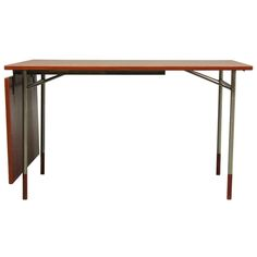 20th Century Scandinavian Design Desk in Teak and Metal by Finn Juhl | From a unique collection of antique and modern desks and writing tables at http://www.1stdibs.com/furniture/tables/desks-writing-tables/