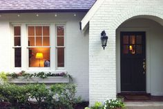 white brick, black accents | Nest Egg...if we have to buy a brick house..paint them white!