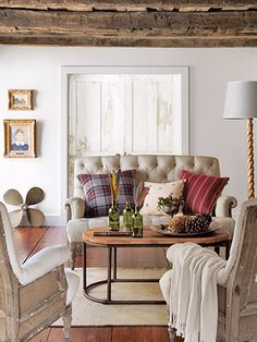 A settee and two armchairs by Restoration Hardware cozy up to a Zentique coffee table.