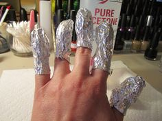 Remove acrylic nails or nail polish with cotton balls dipped in nail polish remover and then cover them with foil