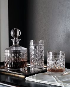 "Lauren Ralph Lauren""Aston"" Crystal Barware           Intricately faceted barware from Lauren Ralph Lauren. Dishwasher safe. Decanter holds 28 ounces. Highballs hold 12 ounces. Double old-fashioneds hold 10 ounces."