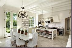 Love the gray-tone travertine with the marble+custom-made marble table