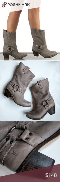 Frye Carmen Harness Short Boots in Gray A classic look with a modern spin, take this cute ankle boot with you anywhere. Grey leather covered boot with a metal hardware detail and studs. This pull on style brings you 2 1/2 inch block heel to give you a lift.  Shoe Details:  Leather Upper  Leather Sole  This shoe fits true to size.  First pic is a stock image, all others are my own. Please see pics for condition, there are some darker colored spots on the boots but nothing major. These will…