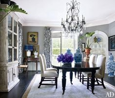 When Lucky Brand execs Dave DeMattei and Patrick Wade bought their 1920s Beverly Hills mansion, they knew they needed to renovate. They gave the dining room personality by pairing gray walls with curtains of a modern print from Barclay Butera Home | archdigest.com