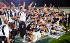 Dr. Mark celebrates with the team after their National Championship Victory.