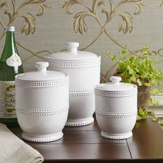 Crafted of embossed earthenware, this set includes three lidded canisters. Farmhouse Kitchen Canisters, Dinnerware, Lidded Canisters, French Country Kitchen, Jar, Country Kitchen, Canisters, Kitchen Canisters, Glass Candy