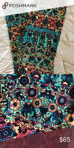 Lularoe TC Stained Glass Watercolor Damask BNWOT never tired on. Size TC. Tie dye aztec.    Amazing colors!    Unicorn Very HTF.   Tons of teals and blues with splashes of neon pink.  Will be perfect all summer long! LuLaRoe Pants Leggings