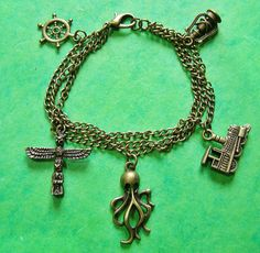 Steampunk Charm Bracelet, Octopus, Train,  Handmade Arts and Craft,  Bronze by ArtandThingsUK on Etsy