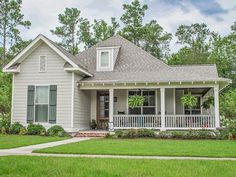 This charming country cottage invites you to kick back on the welcoming wraparound porch in front or the side porch that connects to the garage in back. The open layout inside flows from the great room (featuring a warming fireplace) to the island kitchen