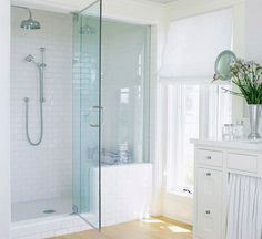 Love the large glass door! Light and Bright Walk-In Shower. I want to get rid of the show/tub combo and do a walk-in shower! Love the blue glass and the white tiles! Bathroom Renos, White Bathroom, Small Bathroom, White Shower, Bathroom Renovations, Bathroom Ideas, Design Bathroom, Bathroom Interior, Modern Bathroom