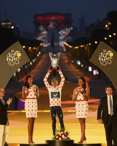 Movistar team rider and best climber's polka dot jersey Nairo Alexander Quintana of Colombia celebrates on the podium