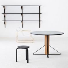 Bouroullec brothers design a bent steel triangle to frame Artek furniture collection.
