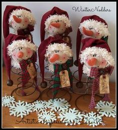 """""""WINTER NODDERS"""" Winter Nodders are a bit smaller than Mr. They are crafted using rusty beehive bed springs. Each nodder wea. Noel Christmas, Primitive Christmas, Rustic Christmas, Christmas Ornaments, Snowman Crafts, Christmas Projects, Holiday Crafts, Bed Spring Crafts, Spring Projects"""