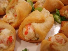 Crab-Filled Crescent Wontons - Just mix together some chopped crab meat (I used the imitation stuff), cream cheese, mayonnaise, green onion, and cayenne pepper in a bowl. Roll in pillsbury cresent roll, brush with egg whites and bake until brown