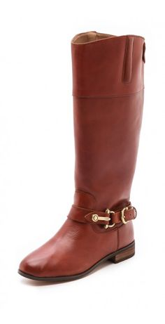 CHANNY TALL BOOTS $37.78 Classic Dolce Vita riding boots with a buckled strap detail. Snap-tab and padded accents at the top line. Stacked heel. Synthetic sole.