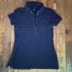 Black Polo Shirt Polo shirt has lots of buttons to open for short (or low) cleavage. Top button hole is accented with turquoise thread. Has small pocket on chest. GAP Tops