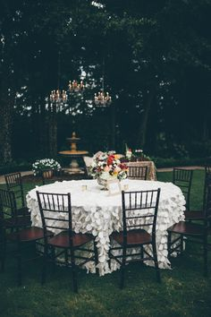 ruffly tables + hanging chandeliers from this glam wedding at Tryphenas Gardens| Image by Amber Phinisee