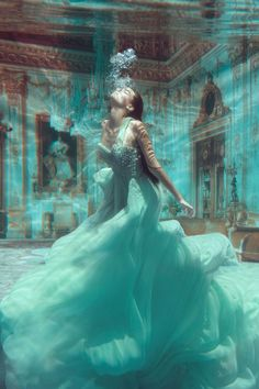 Phoebe Rudomino - decending Art - this is a real picture in a room /set filled with Water