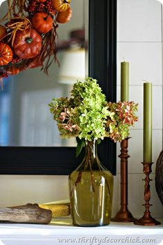 fall mantel decorating / / LOVE the candlesticks. goodwill finds spraypainted copper by Thrifty decor chick.