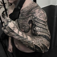 sleeve tattoo themes for men | Photo by (the.inked.society) on Instagram