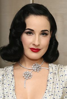 Dita Von Teese Photos - Model Dita Von Teese attends the unveiling of Van Cleef & Arpels redesigned New York 5th Avenue Flagship Maison at Van Cleef & Arpels on December 10, 2013 in New York City. - Van Cleef & Arpels Host a Cocktail Party