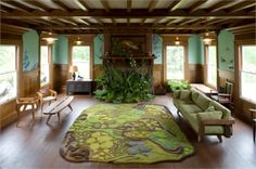 A Forest Floor Rug and Fireplace overflowing with ferns and other lush greens! Rug (etc?) by angelaadams.com