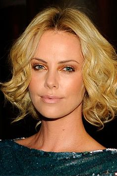 Charlize Theron-Summer makeup look.  Golden bronze smoky eyes with black eyeliner on the inner rims of the eye.