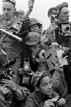 International press photographers covering the Korean War, Kaesong, South Korea, 1952.