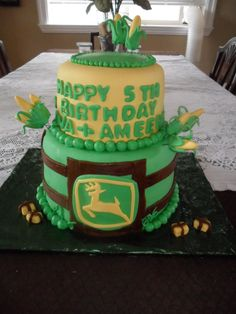 For the last three years I have been privileged to do the birthday cakes for two of the most darling twin girls I've ever seen. This year the party was a farm theme and what says farm better than John Deere?
