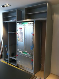 New Gaggenau Vario fridge freezer is wheeled into its housing ready for the doors to be fitted. Freezer, Showroom, Lockers, Locker Storage, Kitchen Ideas, Doors, Cabinet, Furniture, Home Decor