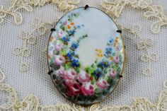 Victorian hand painted porcelain pin by RedFarmhouseVintage on Etsy https://www.etsy.com/listing/289514285/victorian-hand-painted-porcelain-pin