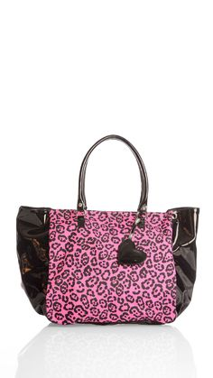 Animal print fabric and patent leather shopping bag, short patent handles, heart shape charm, inner pocket with zip, inner telephone pocket. David Bluh bags