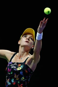 Agnieszka Radwanska of Poland in action in her match against Petra Kvitova of Czech Republic during day two of the BNP Paribas WTA Finals tennis at the Singapore Sports Hub on October 21, 2014 in Singapore.