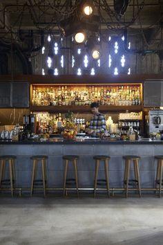 industrial café look. liquor lit up behind bar Bar Interior Design, Cafe Interior, Cafe Design, Architecture Restaurant, Restaurant Design, Cafe Bench, Ice Shop, Restaurants, Industrial Cafe