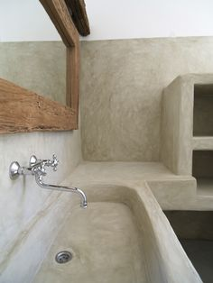 St. Arsenios, Paros island, Greece. Cement mortar in a traditional built bathroom.