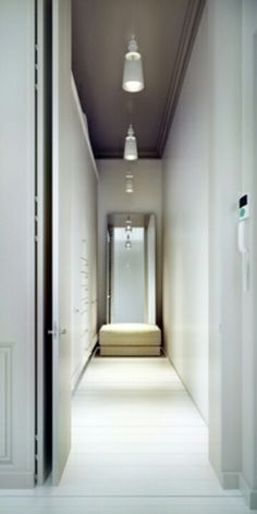 repeating the same lamp throughout the hall, simple and nice