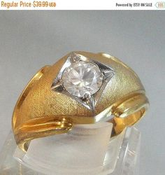 This #vintage men's ring is just gorgeous.  It features a 14k gold electroplated ring with a huge round cut center cubic zirconia CZ stone.   A perfect addition to your vint... #ecochic #etsy #jewelry #jewellery